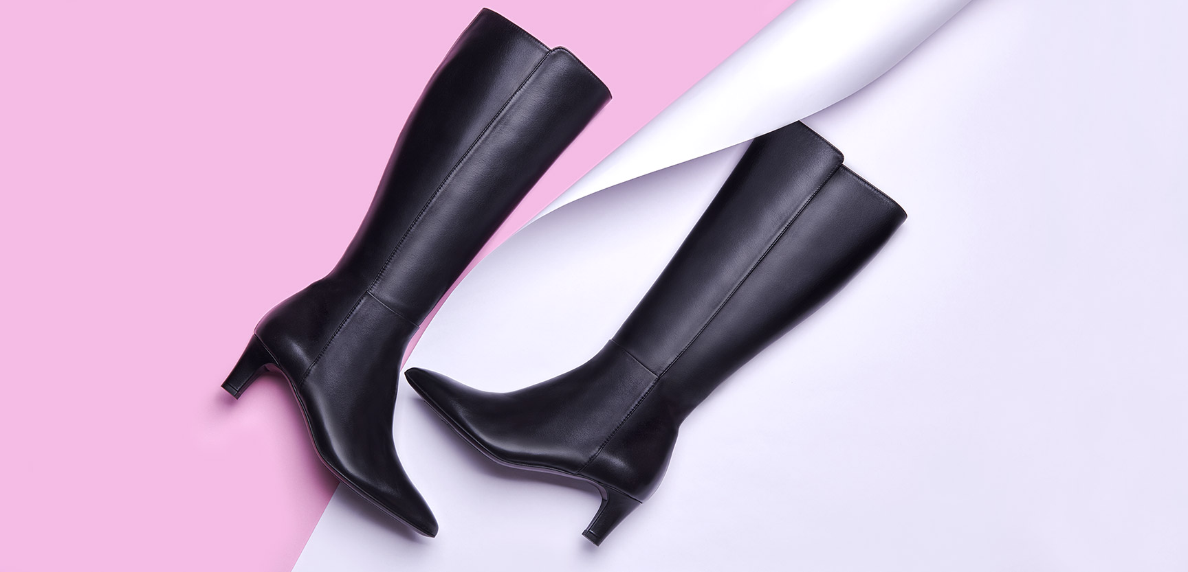 black knee-high boot with women's low heel