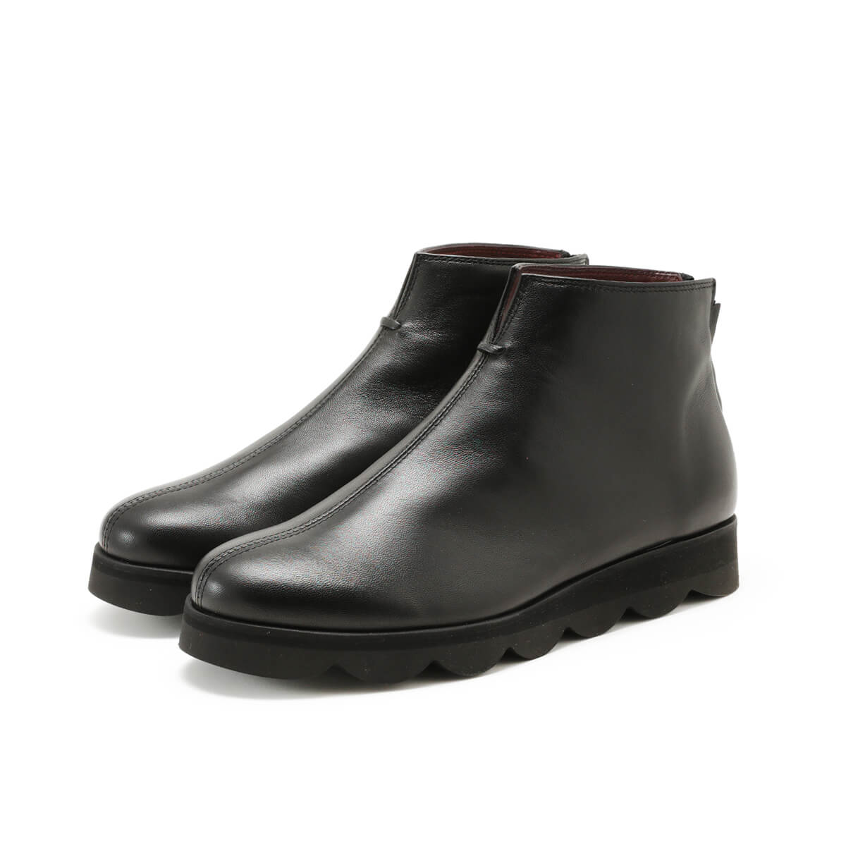 Black back zip ankle boot with light rubber sole